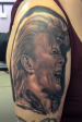 David Bowie black and grey portrait tattoo