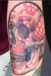 Candy skull arm tattoo