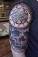 Black and Grey Skull and roman numeral time piece half sleeve.